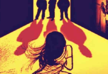 Photo of Another Woman Being Gang-Raped in Front of Her Children